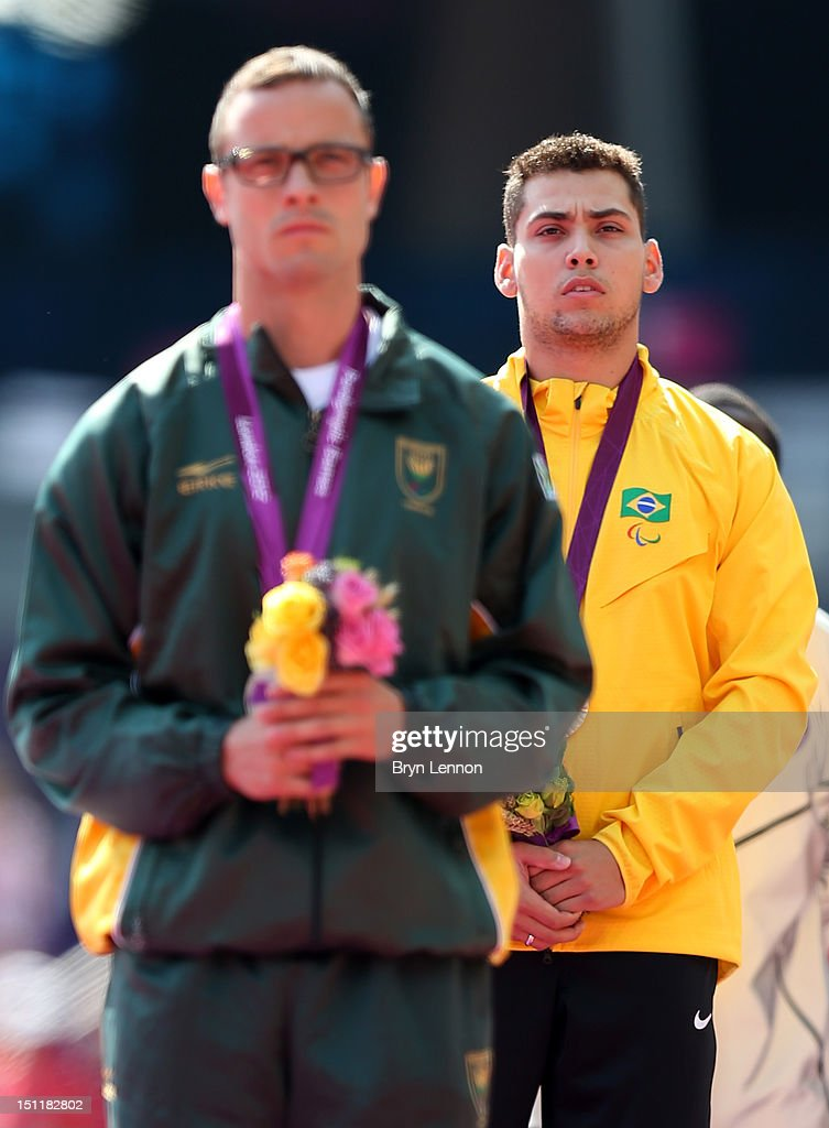 Silver medalist Oscar Pistorius of South Africa and gold medalist Alan Fonteles Cardoso Oliveira pose on the podium during the medal ceremony for the...