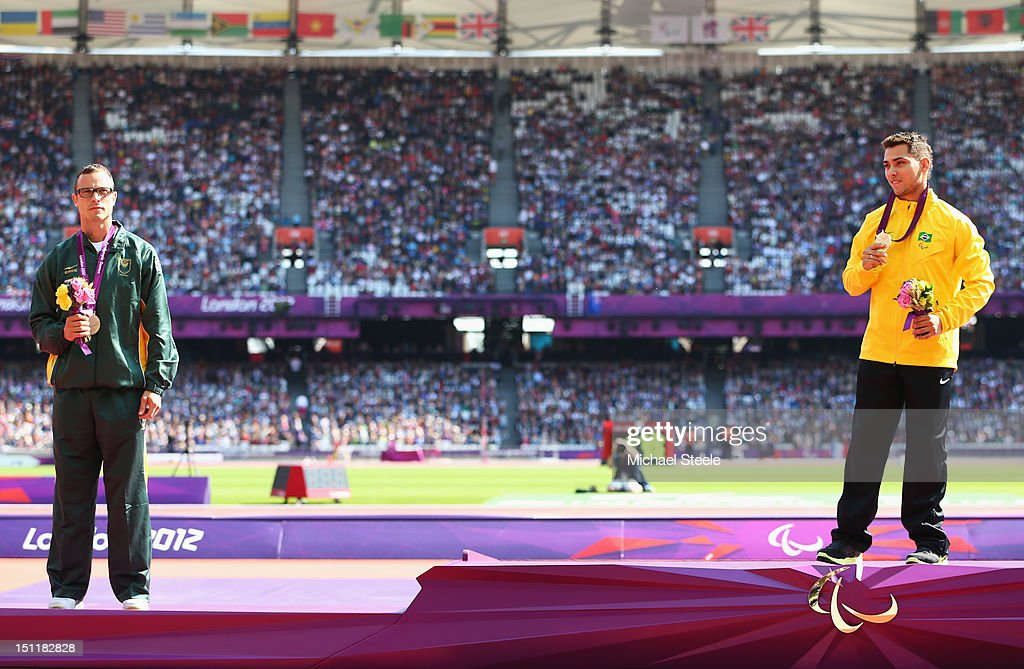 Silver medalist Oscar Pistorius of South Africa and gold medalist Alan Fonteles Cardoso Oliveira pose on the podium during the medal ceremony for the Men's 200m - T44 on day 5 of the London 2012 Paralympic Games at Olympic Stadium on September 3, 2012 in London, England.