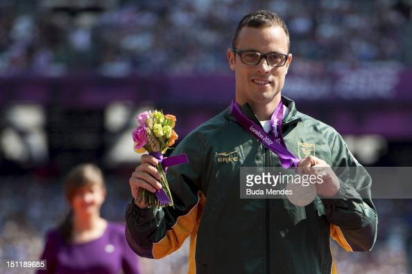 Silver medalist Oscar Pistorius of South Africa poses on the podium during the award ceremony for the Men's 200m T44 on September 03 2012 in London...