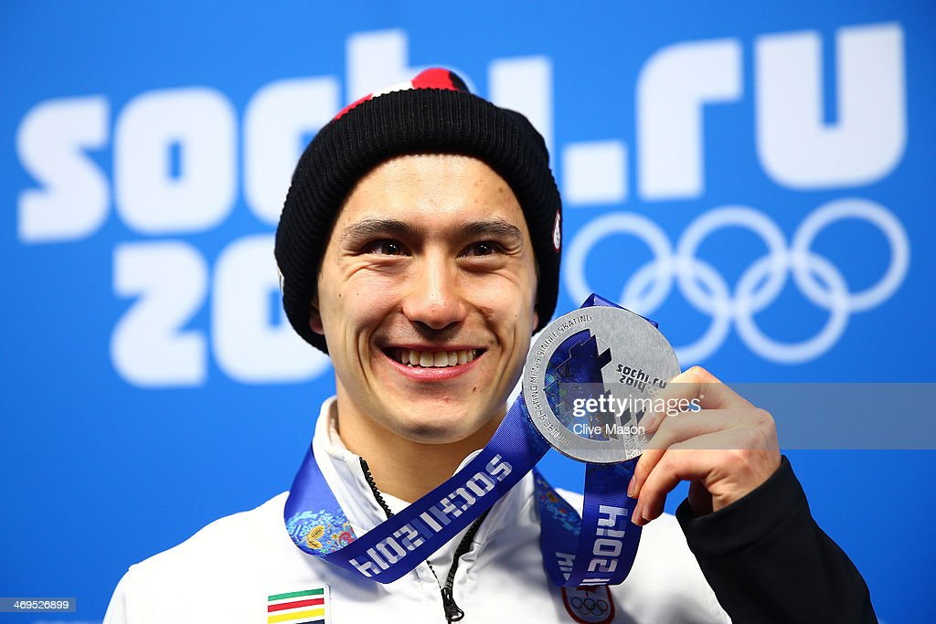 Silver medalist Patrick Chan of Canada celebrates during the medal ceremony for the Men's Figure Skating on day 8 of the Sochi 2014 Winter Olympics at Medals Plaza on February 15, 2014 in Sochi, Russia.