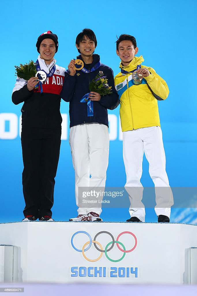 Silver medalist <a gi-track='captionPersonalityLinkClicked' href=/galleries/search?phrase=Patrick+Chan&family=editorial&specificpeople=4036503 ng-click='$event.stopPropagation()'>Patrick Chan</a> of Canada, gold medalist Yuzuru Hanyu of Japan and bronze medalist <a gi-track='captionPersonalityLinkClicked' href=/galleries/search?phrase=Denis+Ten&family=editorial&specificpeople=5776186 ng-click='$event.stopPropagation()'>Denis Ten</a> of Kazakhstan on the podium during the medal ceremony for the Menfs Figure Skating on day 8 of the Sochi 2014 Winter Olympics at Medals Plaza on February 15, 2014 in Sochi, Russia.