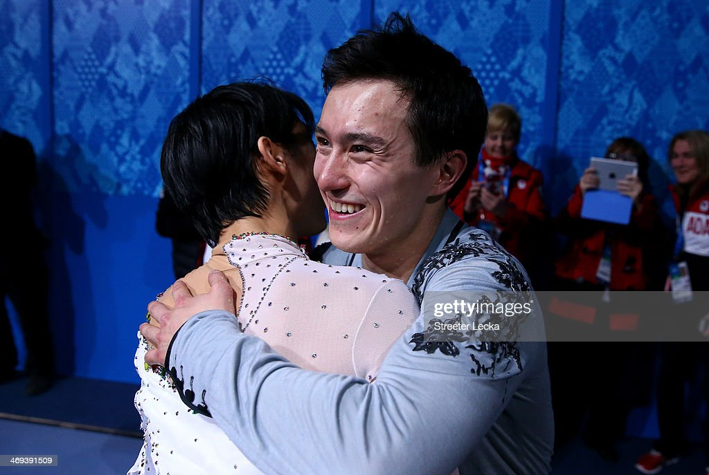 Silver medalist Patrick Chan of Canada hugs Yuzuru Hanyu of Japan who won the gold after he Figure Skating Men's Free Skating on day seven of the Sochi 2014 Winter Olympics at Iceberg Skating Palace on February 14, 2014 in Sochi, Russia.