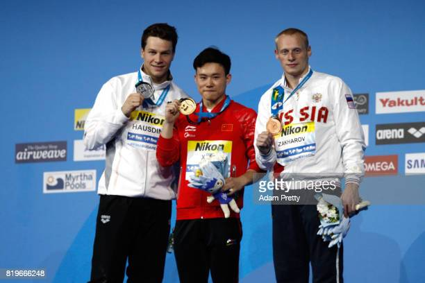 Silver medalist Patrick Hausding of Germany gold medalist Siyi Xie of China and bronze medalist Ilia Zakharov of Russia pose with the medals won...