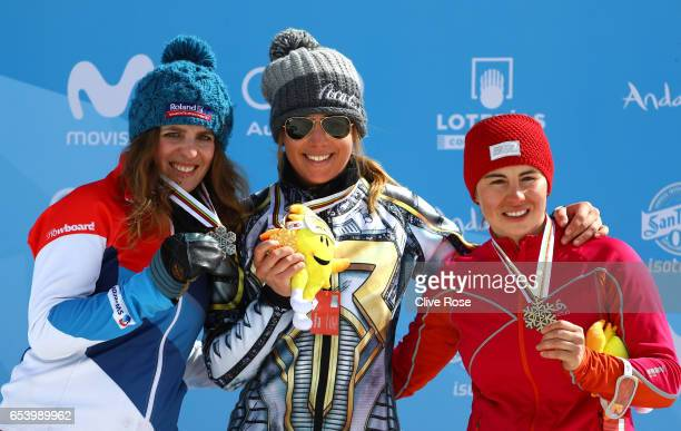 Silver medalist Patrizia Kummer of Switzerland gold medalist Ester Ledecka of the Czech Republic and bronze medalist Ekaterina Tudegesheva of Russia...