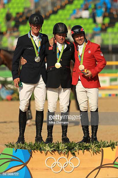 R] Silver medalist Peder Fredricson of Sweden riding All In gold medalist Nick Skelton of Great Britain riding Big Star and bronze medalist Eric...