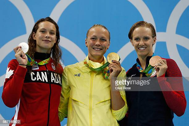 Silver medalist Penny Oleksiak of Canada gold medalist Sarah Sjostrom of Sweden and bronze medalist Dana Vollmer of the United States pose on the...