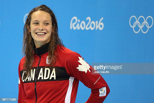 Silver medalist Penny Oleksiak of Canada poses during the medal ceremony for the Women's 100m Butterfly Final during the swimming competition of the...