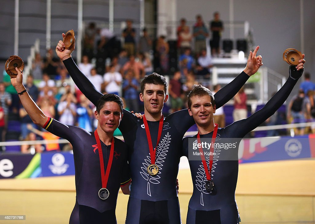 Silver medalist <a gi-track='captionPersonalityLinkClicked' href=/galleries/search?phrase=Peter+Kennaugh&family=editorial&specificpeople=5542463 ng-click='$event.stopPropagation()'>Peter Kennaugh</a> of the Isle of Man, gold medalist Tom Scully of New Zealand and bronze medalist <a gi-track='captionPersonalityLinkClicked' href=/galleries/search?phrase=Aaron+Gate&family=editorial&specificpeople=7235084 ng-click='$event.stopPropagation()'>Aaron Gate</a> of New Zealand celebrate during the medal ceremony for the Men's 40km Points Race final at Sir Chris Hoy Velodrome during day three of the Glasgow 2014 Commonwealth Games on July 26, 2014 in Glasgow, United Kingdom.