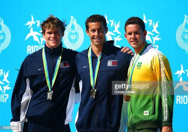 Silver medalist Peter Marshall of USA gold medalist Randall Bal of USA stand with Thiago Pereira of Brazil after receiving their medals for the Men's...