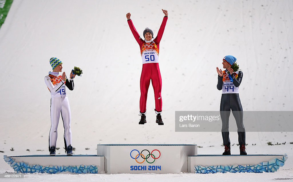 Silver medalist <a gi-track='captionPersonalityLinkClicked' href=/galleries/search?phrase=Peter+Prevc&family=editorial&specificpeople=6667561 ng-click='$event.stopPropagation()'>Peter Prevc</a> of Slovenia, gold medalist <a gi-track='captionPersonalityLinkClicked' href=/galleries/search?phrase=Kamil+Stoch&family=editorial&specificpeople=820513 ng-click='$event.stopPropagation()'>Kamil Stoch</a> of Poland and bronze medalist <a gi-track='captionPersonalityLinkClicked' href=/galleries/search?phrase=Anders+Bardal&family=editorial&specificpeople=2146620 ng-click='$event.stopPropagation()'>Anders Bardal</a> of Norway celebrate on the podium during the flower ceremony for the Men's Normal Hill Individual Final on day 2 of the Sochi 2014 Winter Olympics at the RusSki Gorki Ski Jumping Center on February 9, 2014 in Sochi, Russia.