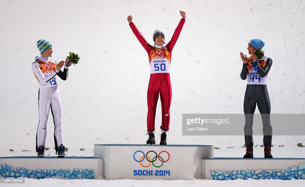 Silver medalist Peter Prevc of Slovenia, gold medalist Kamil Stoch of Poland and bronze medalist Anders Bardal of Norway celebrate on the podium during the flower ceremony for the Men's Normal Hill Individual Final on day 2 of the Sochi 2014 Winter Olympics at the RusSki Gorki Ski Jumping Center on February 9, 2014 in Sochi, Russia.
