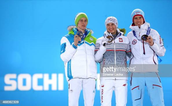 Silver medalist Peter Prevc of Slovenia gold medalist Kamil Stoch of Poland and bronze medalist Anders Bardal of Norway celebrate during the medal...