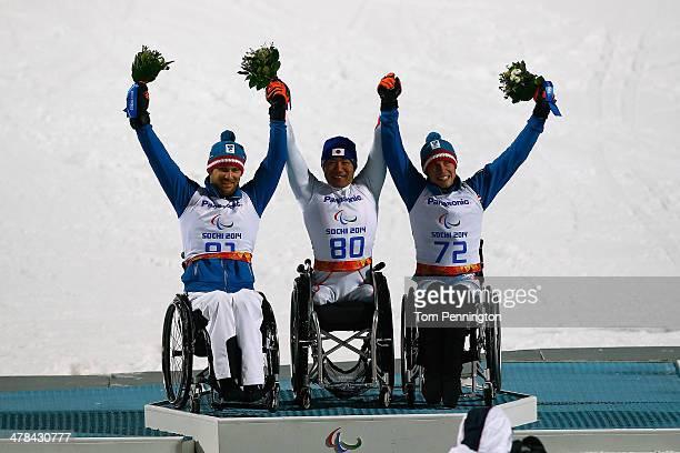 Silver medalist Philipp Bonadimann of Austria Gold medalist Takeshi Suzuki of Japan and bronze medalist Roman Rabl of Austria celebrate during the...