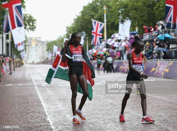 Silver medalist Priscah Jeptoo of Kenya and fourth place Mary Jepkosgei Keitany of Kenya after competing in the Women's Marathon on Day 9 of the...