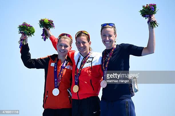Silver medalist Rachel Klamer of Netherlands gold medalist Nicola Spirig of Switzerland and bronze medalist Lisa Norden of Sweden celebrate with...
