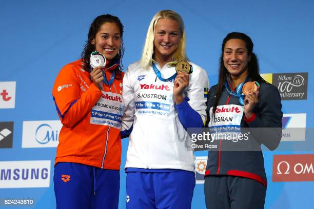 Silver medalist Ranomi Kromowidjojo of the Netherlands gold medalist Sarah Sjostrom of Sweden and bronze medalist Farina Osman of Egypt pose with the...
