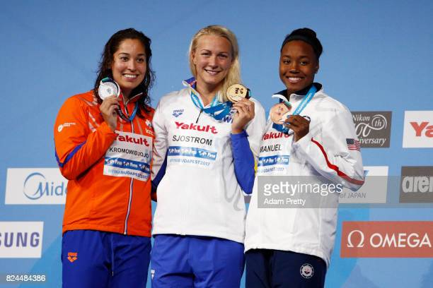 Silver medalist Ranomi Kromowidjojo of the Netherlands gold medalist Sarah Sjostrom of Sweden and bronze medalist Simone Manuel of the United States...
