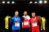 Silver medalist Rasmus Magi of Estonia gold medalist Kariem Hussein of SwitzerlaKariem Hussein of Switzerlandand bronze medalist Denis Kudryavtsev of...