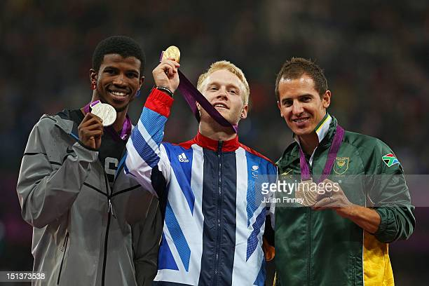 Silver medalist Richard Browne of the United States Gold medalist Jonnie Peacock of Great Britain Bronze medalist Arnu Fourie of South Africa pose on...