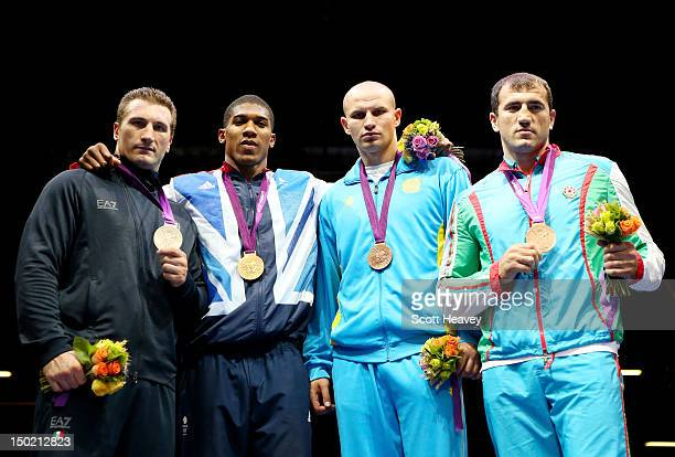 Silver medalist Roberto Cammarelle of Italy gold medalist Anthony Joshua of Great Britain bronze medalist Ivan Dychko of Kazakhstan and bronze...