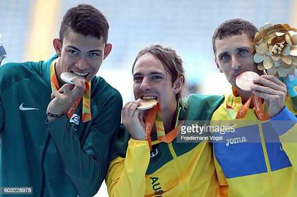 Silver medalist Rodrigo Parreira da Silva of Brazil gold medalist Brayden Davidson of Australia and and bronze medalist Roman Pavlyk celebrates on...