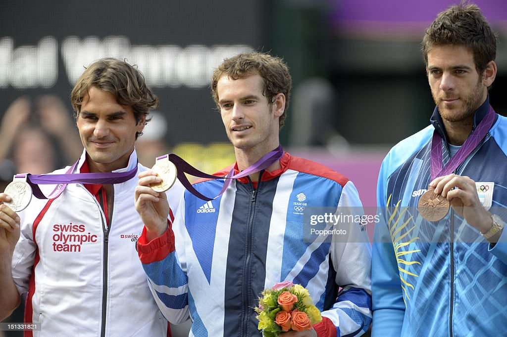 Silver medalist Roger Federer (L) of Switzerland, gold medalist Andy Murray (C) of Great Britain and bronze medalist Juan Martin Del Potro of Argentina pose during the medal ceremony for the Men's Singles Tennis match on Day 9 of the London 2012 Olympic Games at the All England Lawn Tennis and Croquet Club on August 5, 2012 in London, England.