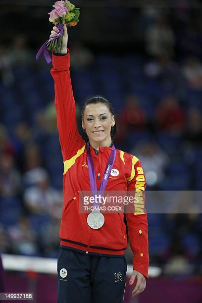 Silver medalist Romania's gymnast Catalina Ponor poses on the podium of the women' s floor exercise of the artistic gymnastics event of the London...