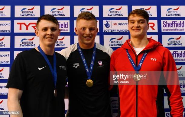 Silver medalist Ross Murdoch of Uni of Stirling gold medalist Adam Peaty of Loughboro Uni and bronze medalist James Wilby of Loughboro Uni pose with...