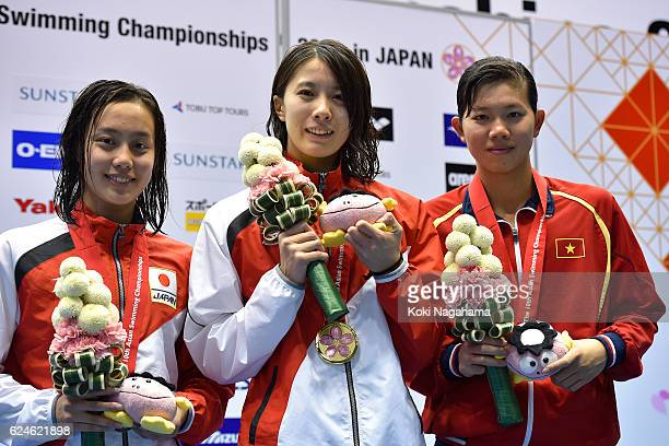 Silver medalist Runa Imai of Japan and Gold medalist Yui Ohashi of Japan and Nguyen Thi Anh Vien of Vietnam pose for photographs after the Women's...