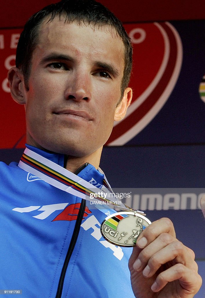 Silver medalist Russia's Alexandr Kolobnev celebrates on the podium of the Elite men's world road race championships at Mendrisio on September 27, 2009. Austrlia's Cadel Evans won ahead of Russia's Alexandr Kolobnev and Spain's Joaquin Rodriguez .