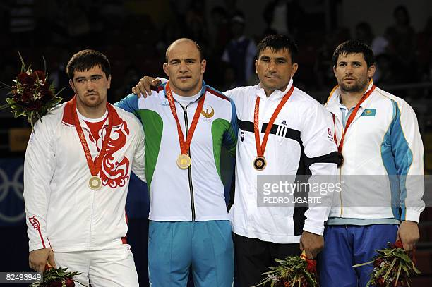 Silver medalist Russia's Bakhtiyar Akhmedov gold medalist Uzbekistan's Artur Taymazov and bronze medalists Slovakia's David Musulbes and Kazakhstan's...