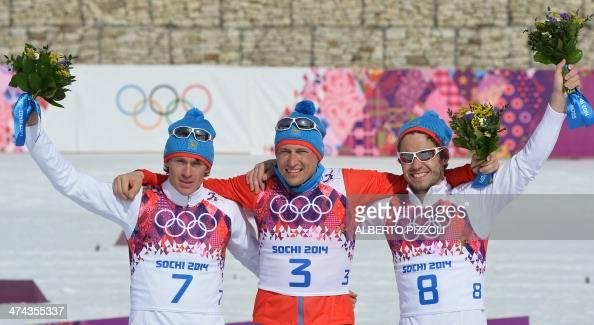 Silver medalist Russia's Maxim Vylegzhanin gold medalist Russia's Alexander Legkov and Bronze medalist Russia's Ilia Chernousov celebrate during the...
