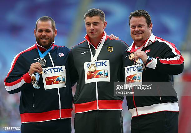 Silver medalist Ryan Whiting of the United States gold medalist David Storl of Germany and bronze medalist Dylan Armstrong of Canada pose on the...