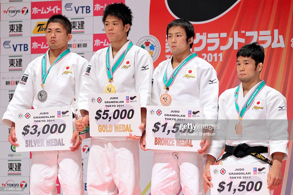 Silver medalist Ryo Kawabata, gold medalist Hirofumi Yamamoto, bronze medalists <a gi-track='captionPersonalityLinkClicked' href=/galleries/search?phrase=Naohisa+Takato&family=editorial&specificpeople=8718702 ng-click='$event.stopPropagation()'>Naohisa Takato</a> and <a gi-track='captionPersonalityLinkClicked' href=/galleries/search?phrase=Hiroaki+Hiraoka&family=editorial&specificpeople=4877249 ng-click='$event.stopPropagation()'>Hiroaki Hiraoka</a> of Japan pose for photographs on the podium during the award ceremony for Men's 60kg on day one of the Judo Grand Slam Tokyo at Tokyo Metropolitan Gymnasium on December 9, 2011 in Tokyo, Japan.