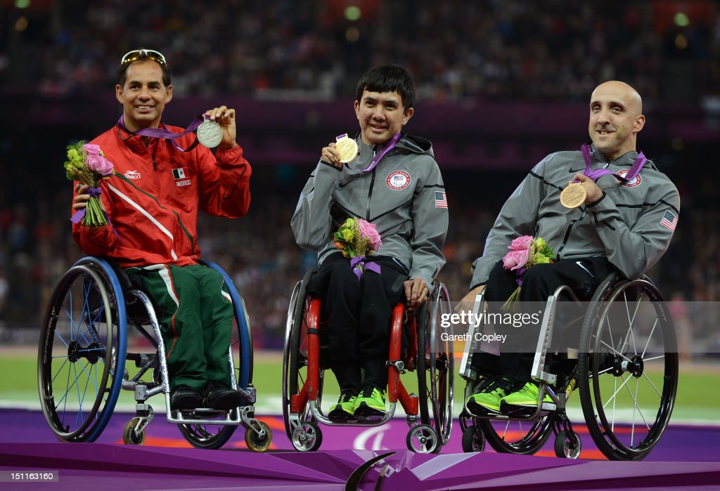Silver medalist Salvador Hernandez Mondragon of Mexico, Gold medalist <a gi-track='captionPersonalityLinkClicked' href=/galleries/search?phrase=Raymond+Martin+-+Wheelchair+Racer&family=editorial&specificpeople=15149289 ng-click='$event.stopPropagation()'>Raymond Martin</a> of the United States and bronze medalist Paul Nitz of the United States pose on the podium during the medal ceremony for the Men's 100m - T52 Final on day 4 of the London 2012 Paralympic Games at Olympic Stadium on September 2, 2012 in London, England.