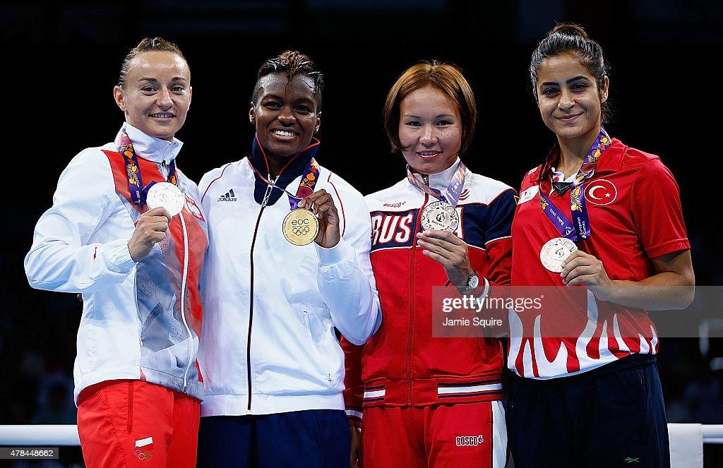 Silver medalist Sandra Drabik of Poland gold medalist Nicola Adams of Great Britain and bronze medalists Saiana Sagataeva of Russia and Elif Coskun...
