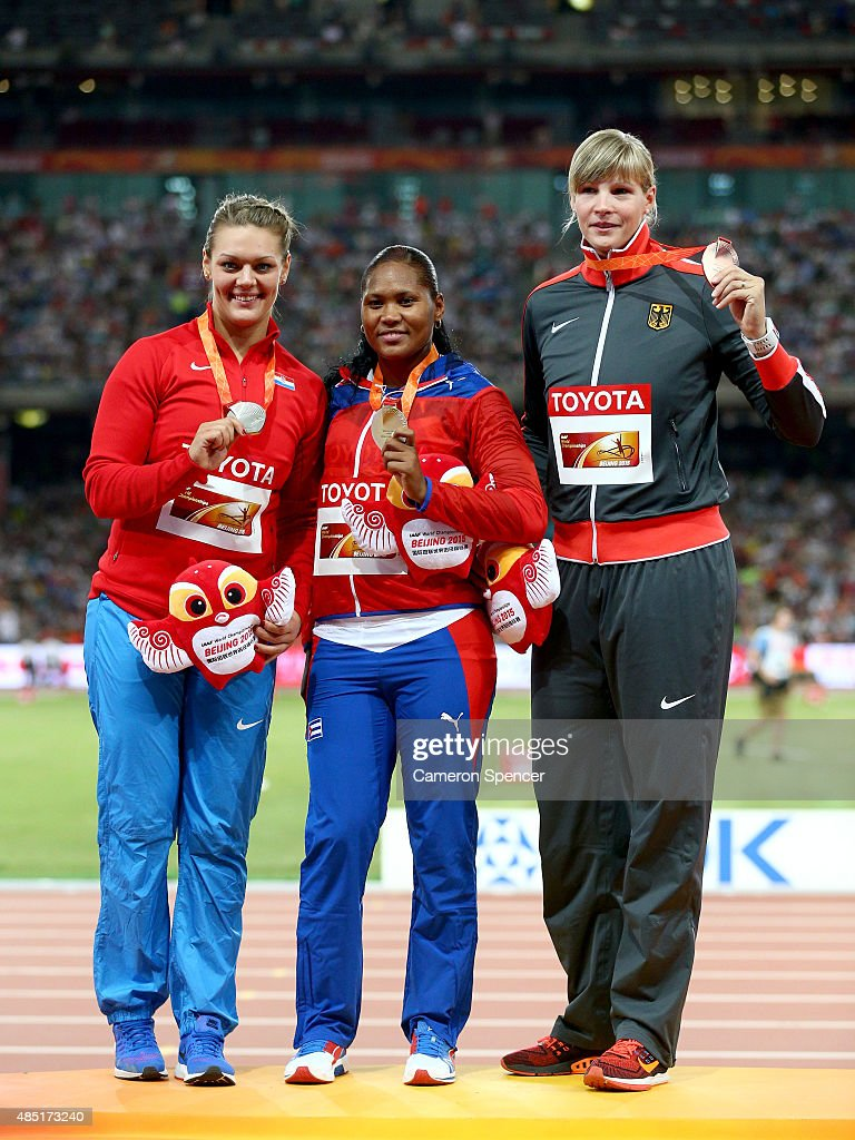 Silver medalist Sandra Perkovic of Croatia, gold medalist Denia Caballero of Cuba and bronze medalist Nadine Muller of Germany pose during the medal ceremony for the Women's Discus final during day four of the 15th IAAF World Athletics Championships Beijing 2015 at Beijing National Stadium on August 25, 2015 in Beijing, China.