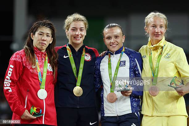 Silver medalist Saori Yoshida of Japan gold medalist Helen Louise Maroulis of the United States bronze medalist Natalya Sinishin of Azerbaijan and...