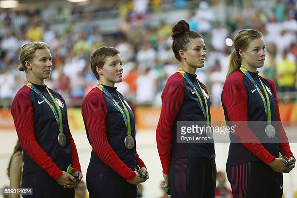 Silver medalist Sarah Hammer Kelly Catlin Chloe Dygert and Jennifer Valente of the United States celebrate on the podium at the medal ceremony for...