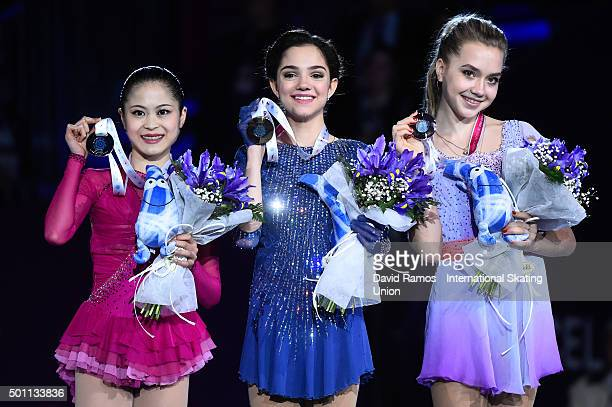 Silver medalist Satoko Miyahara of Japan Gold medalist Evgenia Medvedeva of Russia and Bronze medalist Elena Radionova of Russia pose during the...