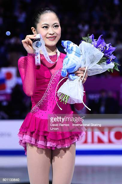 Silver medalist Satoko Miyahara of Japan poses during the Ladies final medal ceremony during day three of the ISU Grand Prix of Figure Skating Final...