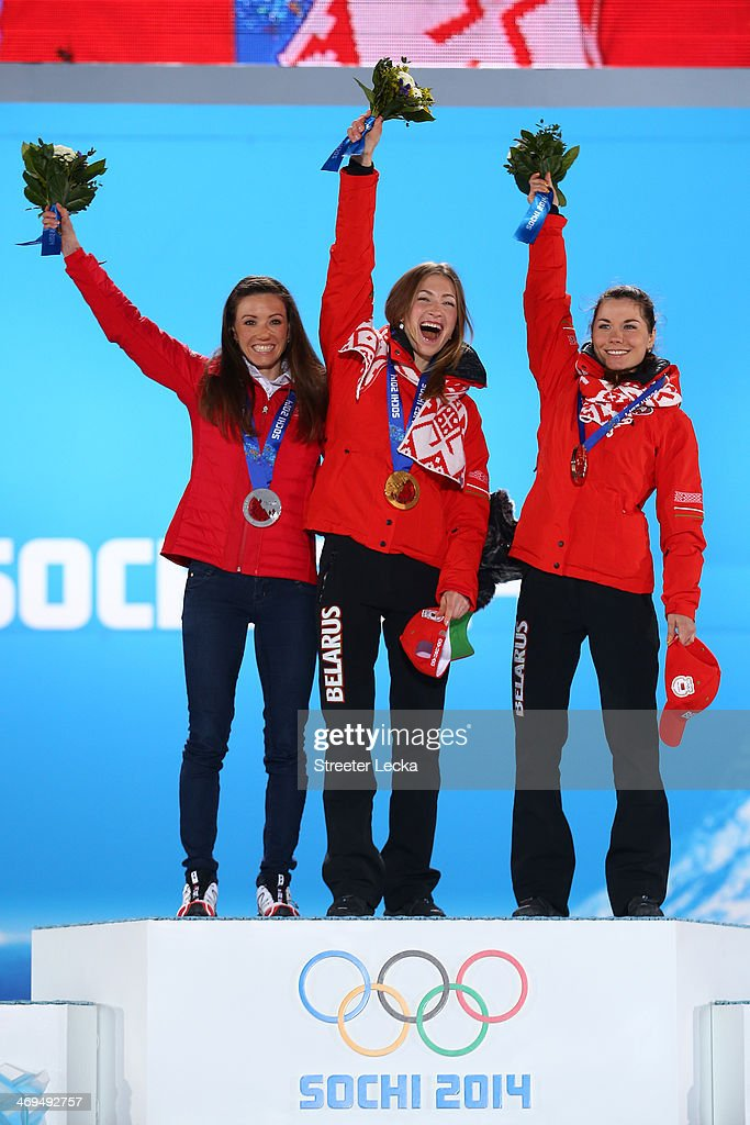 Silver medalist <a gi-track='captionPersonalityLinkClicked' href=/galleries/search?phrase=Selina+Gasparin&family=editorial&specificpeople=5712929 ng-click='$event.stopPropagation()'>Selina Gasparin</a> of Switzerland, gold medalist <a gi-track='captionPersonalityLinkClicked' href=/galleries/search?phrase=Darya+Domracheva&family=editorial&specificpeople=4105955 ng-click='$event.stopPropagation()'>Darya Domracheva</a> of Belarus and bronze medalist <a gi-track='captionPersonalityLinkClicked' href=/galleries/search?phrase=Nadezhda+Skardino&family=editorial&specificpeople=4105956 ng-click='$event.stopPropagation()'>Nadezhda Skardino</a> of Beralus on the podium during the medal ceremony for the Biathlon Women's 15km Individual on day 8 of the Sochi 2014 Winter Olympics at Medals Plaza on February 15, 2014 in Sochi, Russia.