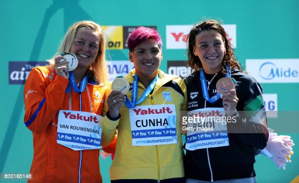 Silver medalist Sharon Van Rouwendaal of the Netherlands gold medalist Ana Marcela Cunha of Brazil and bronze medalist Arianna Bridi of Italy pose...