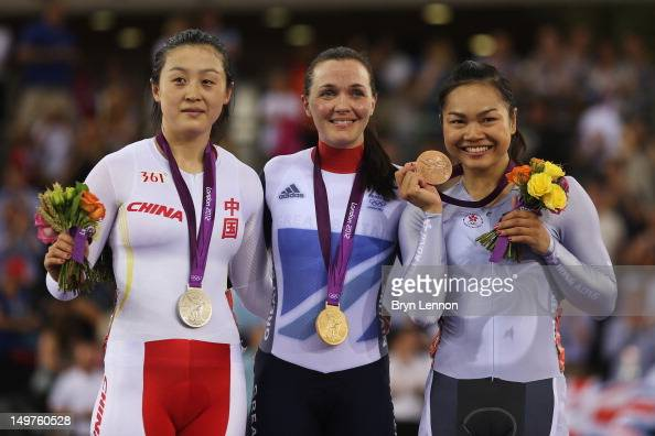 Silver medalist Shuang Guo of China gold medalist Victoria Pendleton of Great Britain and bronze medalist Wai Sze Lee of Hong Kong China celebrate...
