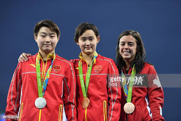 Silver medalist Si Yajie of China gold medalist Ren Qian of China and bronze medalist Meaghan Benfeito of Canada pose on the podium during the medal...