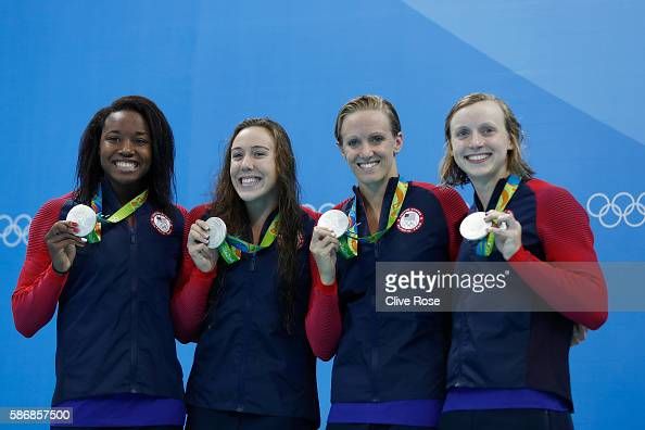 Silver medalist Simone Manuel Abbey Weitzeil Dana Vollmer and Kate Ledecky of the United States pose during the medal ceremony for the Final of the...