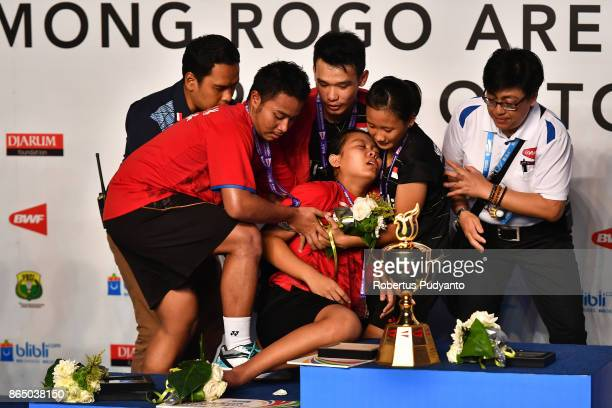 Silver medalist Siti Fadia Silva Ramadhanti of Indonesia collapses during Mixed Doubles awarding ceremony of the BWF World Junior Championships 2017...