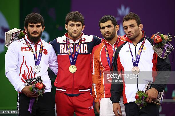 Silver medalist Soner Demirtas of Turkey gold medalist Aniuar Geduev of Russia and bronze medalists Jabrayil Hasanov of Azerbaijan and Jumber...