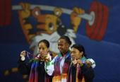 Silver medalist Soniya Chanu Ngangbam of India gold medalist Augustina Nkem Nwaokolo of Nigeria and bronze medalist Sandhya Rani Devi Atom of India...