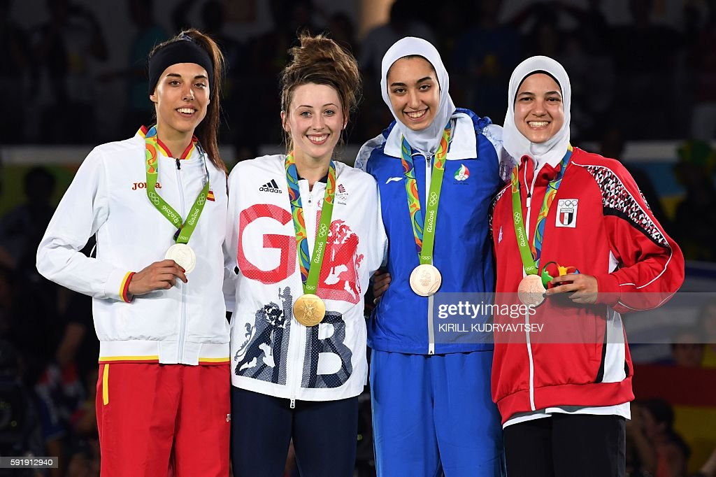 Silver medalist Spain's Eva Calvo Gomez, gold medalist Great Britain's Jade Jones, and bronze medalists Iran's Kimia Alizadeh Zenoorin and Egypt's Hedaya Wahba pose with their medals on the podium after the womens taekwondo event in the -57kg category as part of the Rio 2016 Olympic Games, on August 18, 2016, at the Carioca Arena 3, in Rio de Janeiro. / AFP / Kirill KUDRYAVTSEV